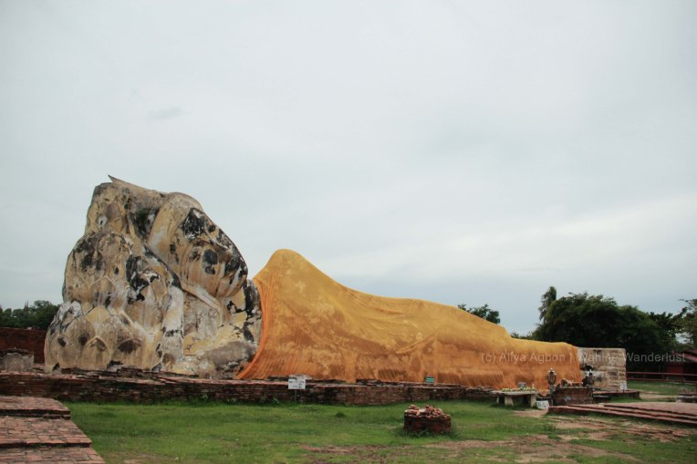 The reclining position portrays that the Buddha passed away peacefully.