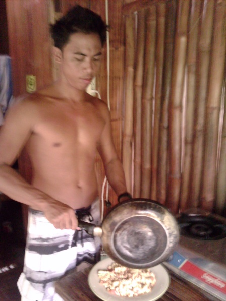 Kuya Ping preparing breakfast for the gang.